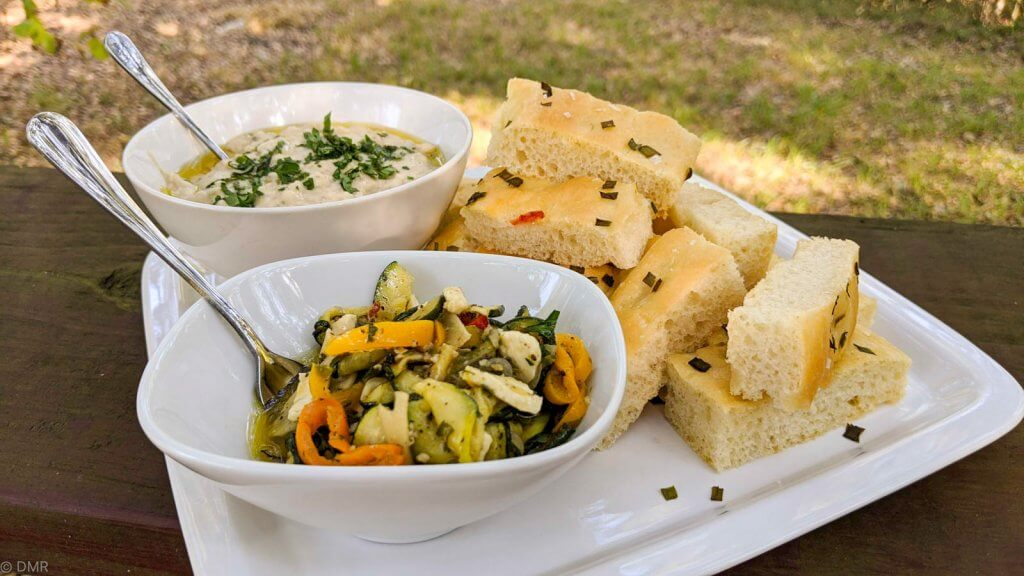 marinated zucchini on plate with focaccia