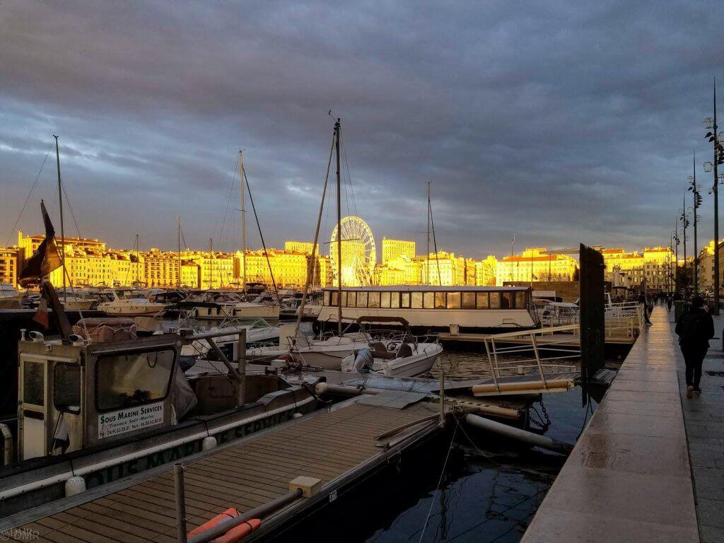 France Marseille golden sunset ferris wheel Vieux Port