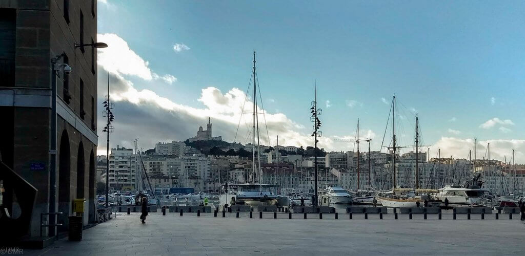 France Marseille Vieux Port with boats and basilica hilltop