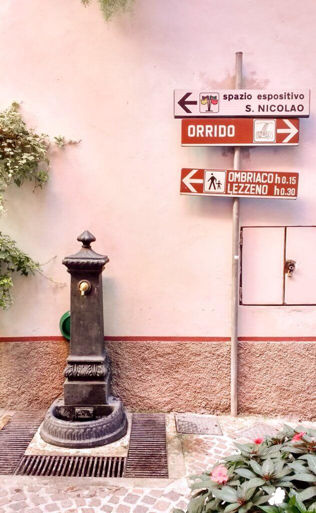 Lake Como Italy Bellano fountain and signs